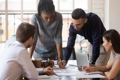 Free Focused Multiracial Corporate Business Team People Brainstorm On Paperwork Royalty Free Stock Photos - 155751478