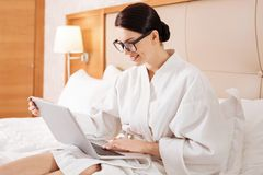 Focused pensive woman holding laptop Royalty Free Stock Photography