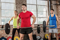 Focused people lifting barbell Royalty Free Stock Images