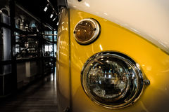 Focused Photo of Clear Headlight of White and Yellow Volkswagen Kombi Royalty Free Stock Image