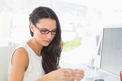 Focused pretty editor working at her desk Royalty Free Stock Photography