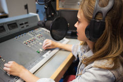 Focused pretty radio host moderating Royalty Free Stock Photo