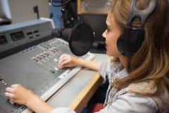 Focused pretty radio host moderating Royalty Free Stock Photo