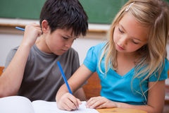 Focused pupils working together Stock Photo