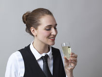 Focused 20s girl tasting bubbly wine at party to celebrate success at becoming sommelier Royalty Free Stock Photos