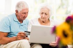 Focused senior couple using laptop Royalty Free Stock Photo