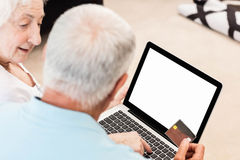 Focused senior couple using laptop Stock Image