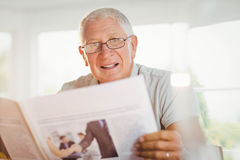 Focused senior man reading newspaper Stock Photo