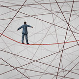 Focused On Strategy. With a businessman as a high wire tight rope walker confronting adversity with a web of confused tangled group of wires trying to distract royalty free illustration