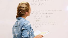 Focused student look at math on whiteboard in classroom Royalty Free Stock Photography
