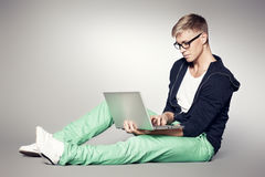 Focused student working on laptop. Royalty Free Stock Photo