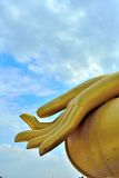 Is focused on taking the hand of Buddha. Royalty Free Stock Photos