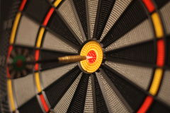 Focused target. Dart and dartboard in the centre of the target. The external part of the target is out of focus stock photos