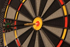 Focused target. Dart and dartboard in the centre of the target. The external part of the target is out of focus royalty free stock images