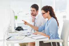 Focused teamwork interacting and pointing computer Royalty Free Stock Images