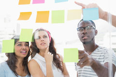 Focused teamwork reading sticky notes Royalty Free Stock Photos