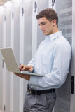 Focused technician typing on his notebook Royalty Free Stock Photo