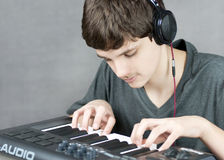 Focused Teen Plays Keyboard Stock Photo