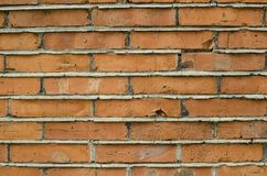 Focused texture of orange solid brick wall Stock Photography