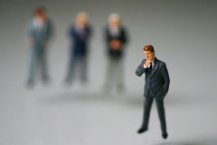Focused on thinking. Miniature people thinking about business stock photography