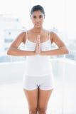 Focused toned brunette meditating Stock Image
