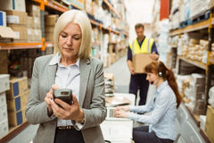 Focused warehouse manager using handheld Stock Photos