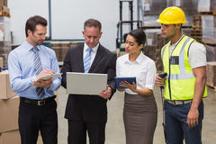 Focused warehouse team working together Royalty Free Stock Image