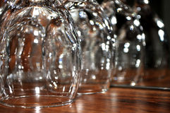 Focused wine glasses on a wooden shelf in a restaurant. Novi Sad, Serbia Royalty Free Stock Photos