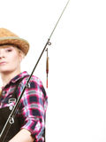 Focused woman looking at fishing rod float Royalty Free Stock Photo