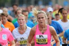 Focused woman running Royalty Free Stock Image
