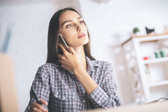 Focused woman talking on mobile phone Royalty Free Stock Image