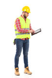 Focused worker using a digital tablet Stock Photography