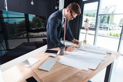 Free Focused Young Businessman In Eyeglasses Working With Papers Stock Photography - 119763902