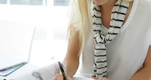 Focused young creative designer sketching ideas stock footage