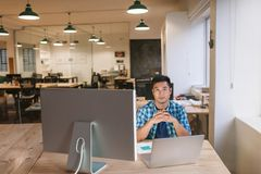 Focused young designer sitting at his workstation in an office Stock Photo