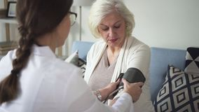 Physician visit old lady at her house to measuring pressure