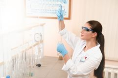 Focused young sciencist pipetting solution into the glass cuvette Royalty Free Stock Photo