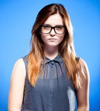Focused young woman with nerd glasses, strict girl Royalty Free Stock Photo