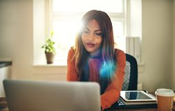 Free Focused Young Woman Working Online In Her Home Office Royalty Free Stock Image - 103201836