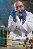 Focuses scientist looking at molecule model royalty free stock photography