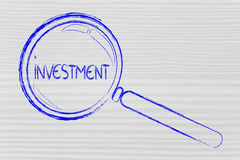 Focusing on investment. Magnifying glass seeking good investment Royalty Free Stock Photo