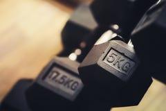 Focusing on 5 kilogram dumbbell Royalty Free Stock Images