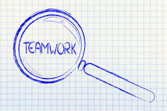 Focusing on teamwork and collaboration. Magnifying glass seeking collaboration and teamwork in business Stock Photography