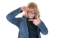 Focusing, teenager student. Attractive trendy blond teenager student, making box gesture with hands, focusing on study, white background stock image