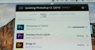 Focusing to Updating Adobe Photoshop status bar on Apple Computer screen stock footage