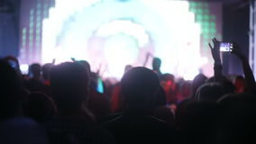 Focusing and unfocusing shot of the night club with concert of the band. Trendy fashion entertainment night party people stock video footage