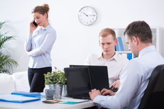 Focusing on the work. Businessman are focusing on their work in the office royalty free stock photo
