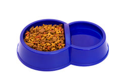 Fodder. Dark blue bowl with pure water and a dry feed for pets Royalty Free Stock Photos