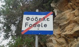 Fodele sign. Street sign with bullet holes. End of Fodele village. Crete. Greece Stock Photo