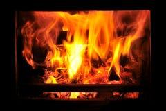 Fogão ardente de madeira com incêndio Foto de Stock Royalty Free
